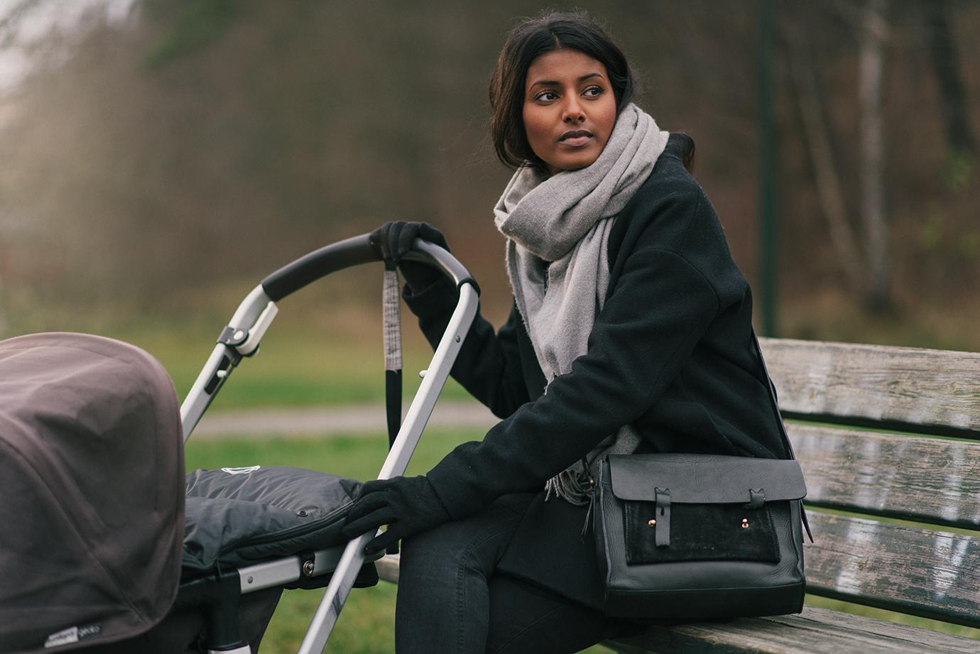 Kvinna med barnvagn